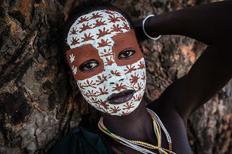 Omo Valley the tribes they have the custom to paint their face and body by transforming their body into a work of art